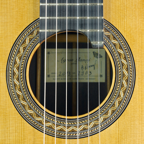 Rosette and label of Classical guitar with doubletop built by luthier Agron Llanaj, with sandwich cedar top and rosewood back and sides scale 65 cm, year 2013