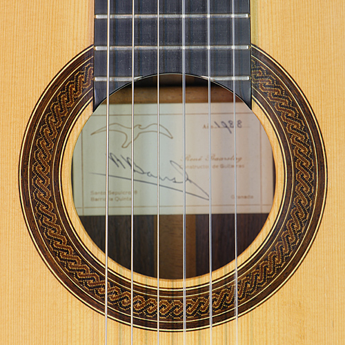 Classical guitar built by guitar maker Rene Baarslag in 1988 with spruce top and rosewood back and sides, scale 65 cm, rosette and label