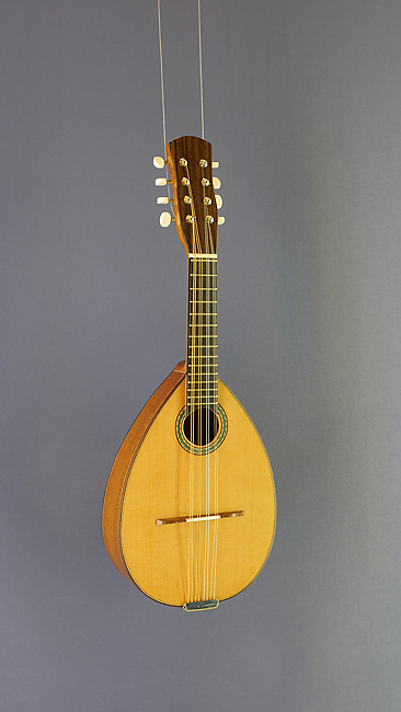 Spanish Mandolin, flat corpus with solid cedar top an sapeli on back and sides